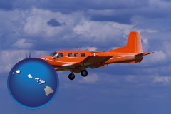 hawaii a red turboprop aircraft flying in a blue sky with cumulus clouds
