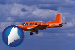 maine a red turboprop aircraft flying in a blue sky with cumulus clouds