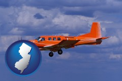 new-jersey a red turboprop aircraft flying in a blue sky with cumulus clouds