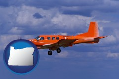 oregon a red turboprop aircraft flying in a blue sky with cumulus clouds