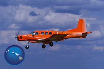 a red turboprop aircraft flying in a blue sky with cumulus clouds - with Hawaii icon