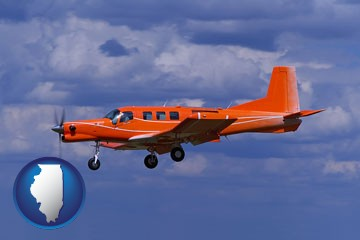 a red turboprop aircraft flying in a blue sky with cumulus clouds - with Illinois icon