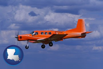 a red turboprop aircraft flying in a blue sky with cumulus clouds - with Louisiana icon