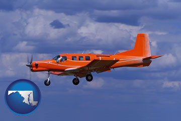 a red turboprop aircraft flying in a blue sky with cumulus clouds - with Maryland icon