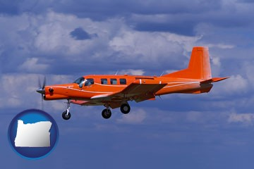 a red turboprop aircraft flying in a blue sky with cumulus clouds - with Oregon icon